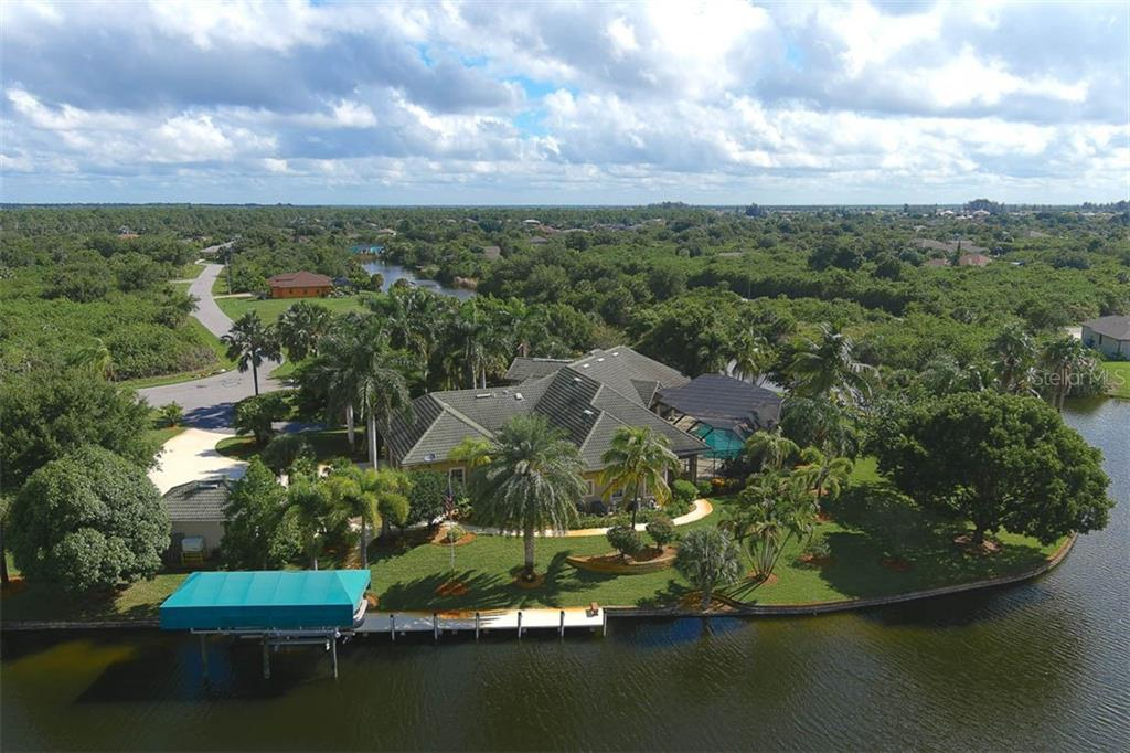Back Aerial View - Single Family Home for sale at 9300 Hialeah Ter, Port Charlotte, FL 33981 - MLS Number is D6113597
