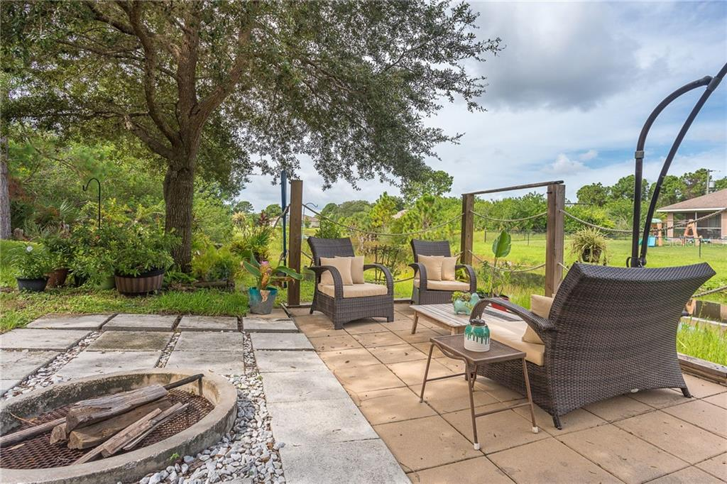 Built-in 11 ft umbrella provides shade even on the sunniest of Florida days! - Single Family Home for sale at 185 Apollo Dr, Rotonda West, FL 33947 - MLS Number is D6113690