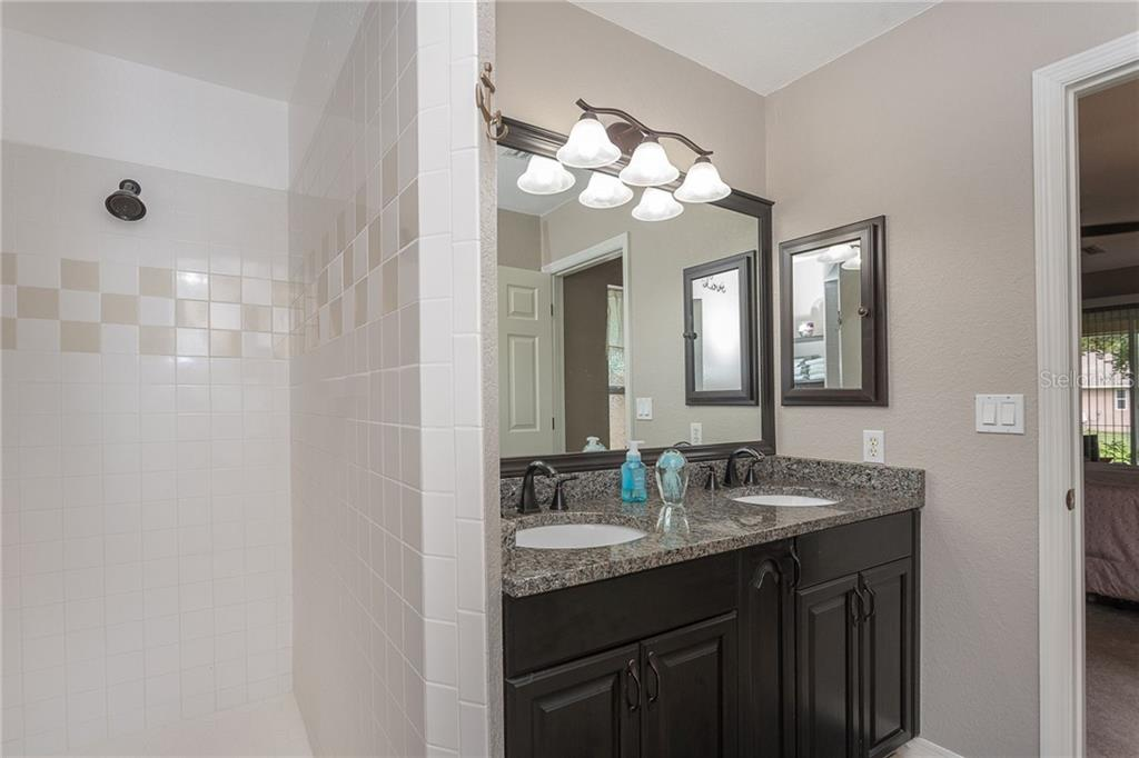 Master bathroom offers a large walk-in style shower and dual sink vanity - Single Family Home for sale at 185 Apollo Dr, Rotonda West, FL 33947 - MLS Number is D6113690