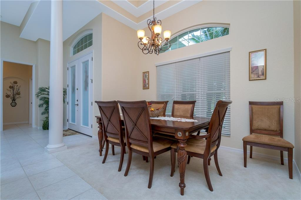 Formal dining area has double tray ceiling. - Single Family Home for sale at 439 Boundary Blvd, Rotonda West, FL 33947 - MLS Number is D6114162
