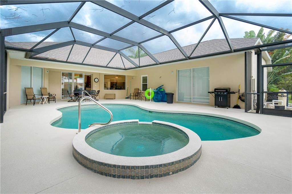 Lots of space for entertaining on the pool deck! - Single Family Home for sale at 439 Boundary Blvd, Rotonda West, FL 33947 - MLS Number is D6114162