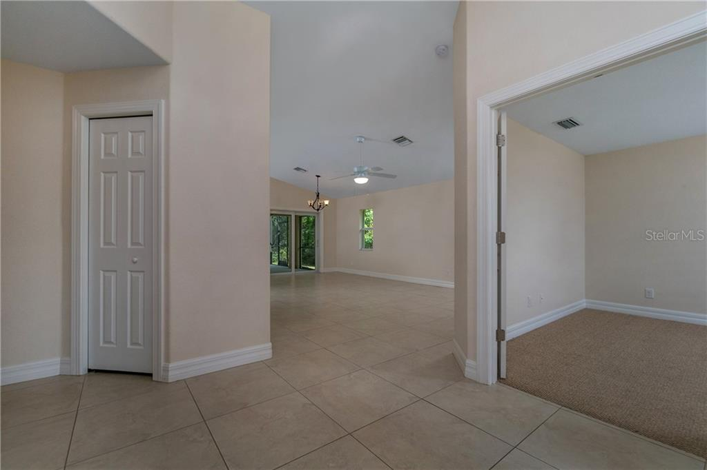 FROM THE ENTRY FOYER LOOKING TOWARDS THE GREAT ROOM. - Single Family Home for sale at 112 Boxwood Ln, Rotonda West, FL 33947 - MLS Number is D6114179