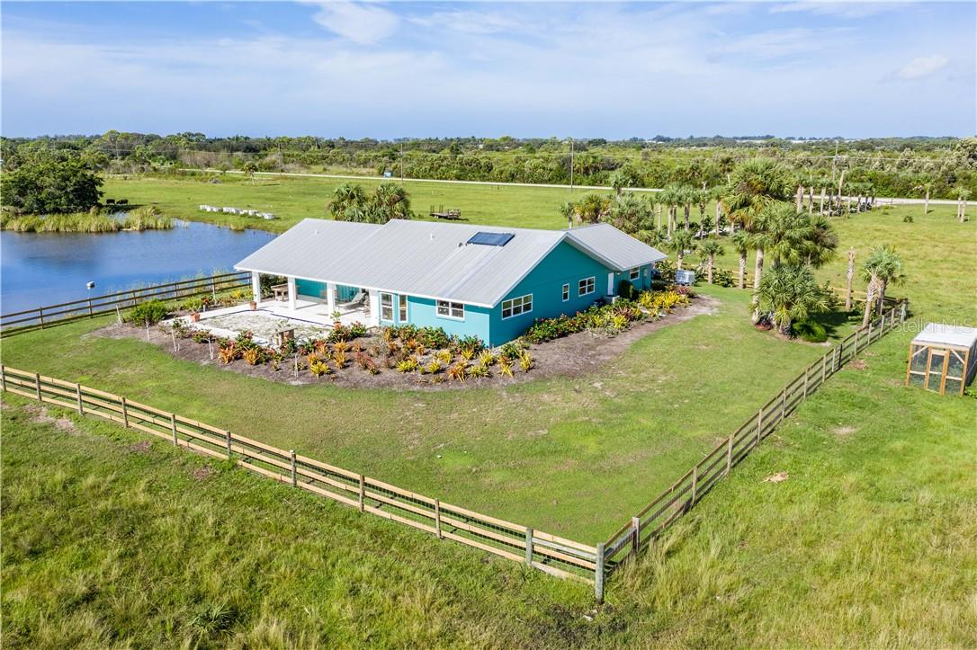 Sunny back patio for gazing out across the farm - Single Family Home for sale at 13000 Gasparilla Rd, Placida, FL 33946 - MLS Number is D6114315