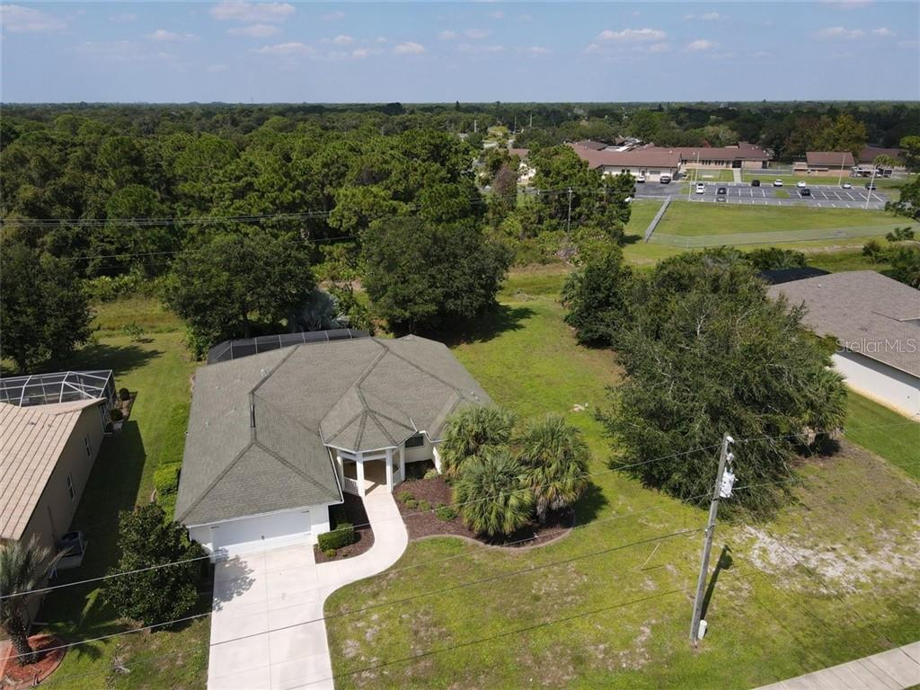 This home sits on 0.33 acres.  The lot to the right is also available. - Single Family Home for sale at 427 Boundary Blvd, Rotonda West, FL 33947 - MLS Number is D6114396