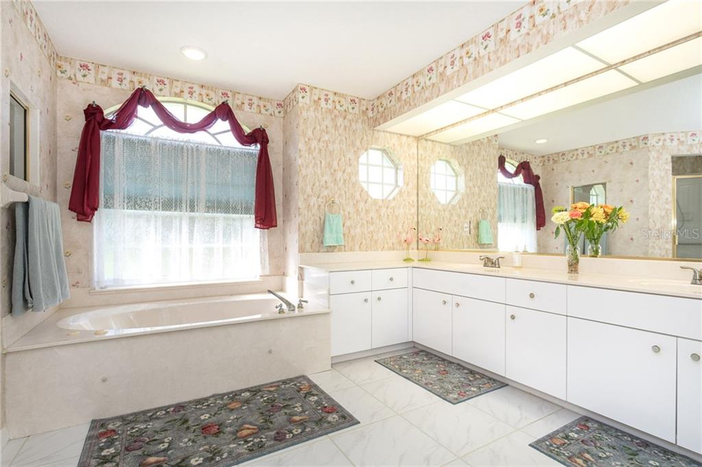 Bathroom 1 had dual sinks, large spa tub and a separate shower stall. - Single Family Home for sale at 1720 Larson St, Englewood, FL 34223 - MLS Number is D6114414