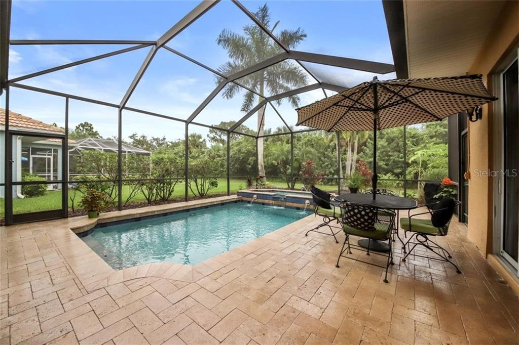 TRAVERTINE DECK SURFACE, POOL AN LARGE SPA - Single Family Home for sale at 1944 Coconut Palm Cir, North Port, FL 34288 - MLS Number is D6114523