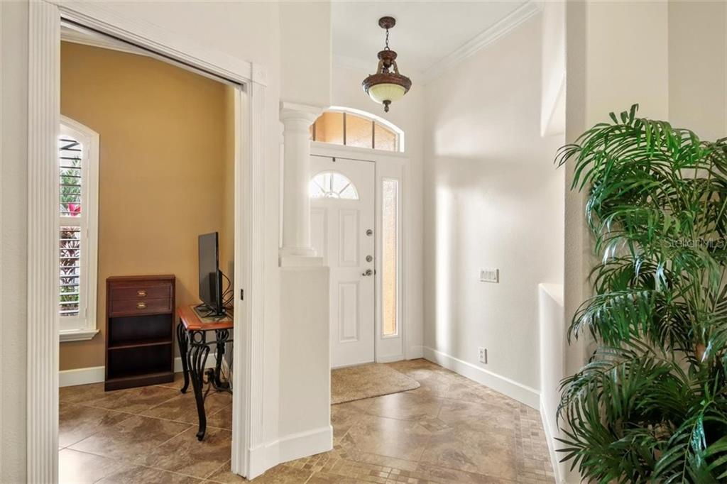 HOME ENTRANCE - Single Family Home for sale at 1944 Coconut Palm Cir, North Port, FL 34288 - MLS Number is D6114523