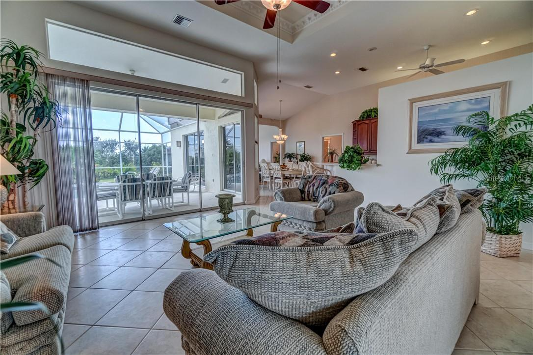 Imagine if you will, relaxing in this spacious living room with guests. Let's see another angle. - Single Family Home for sale at 12307 S Access Rd, Port Charlotte, FL 33981 - MLS Number is D6117140