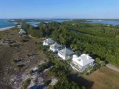 Aerial of Stump Pass - Single Family Home for sale at 7020 Palm Island Dr, Placida, FL 33946 - MLS Number is D5917629