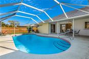 Large custom pool - Single Family Home for sale at 11010 Deerwood Ave, Englewood, FL 34224 - MLS Number is D5921766
