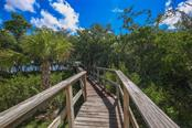 Walkway to Water - Single Family Home for sale at 6100 Palm Point Way, Placida, FL 33946 - MLS Number is D6102528