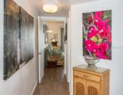 As you enter the unit, you are pleasantly struck by beautiful original artwork. - Condo for sale at 7070 Placida Rd #1223, Placida, FL 33946 - MLS Number is D6108523