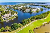 Aerial of house, golf course and surrounding area - Single Family Home for sale at 1600 Gaspar Dr S, Boca Grande, FL 33921 - MLS Number is D6109050
