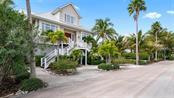 Single Family Home for sale at 7390 Palm Island Dr, Placida, FL 33946 - MLS Number is D6110756