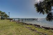 Dock with lights and water for your fishing convenience. - Single Family Home for sale at 918 Edgewater Dr, Englewood, FL 34223 - MLS Number is D6111167