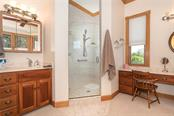 Master bath - large walk-in shower and his & hers vanities. - Single Family Home for sale at 550 S Oxford Dr, Englewood, FL 34223 - MLS Number is D6111512