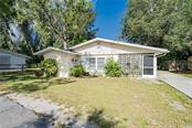 Single Family Home for sale at 740 Liberty St, Englewood, FL 34223 - MLS Number is D6112897