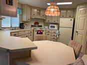 Kitchen - Manufactured Home for sale at 6384 Kilepa Ct, North Port, FL 34287 - MLS Number is D6114877