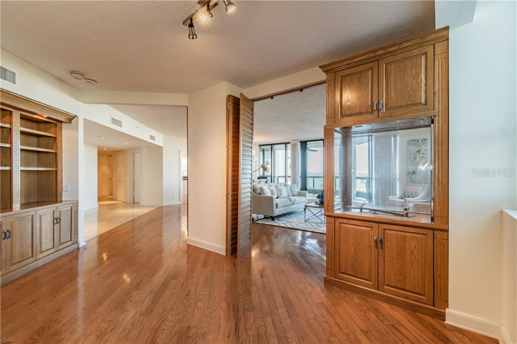 LIVING ROOM, DINING ROOM, DEN - Condo for sale at 1281 Gulf Of Mexico Dr #304, Longboat Key, FL 34228 - MLS Number is T3121789
