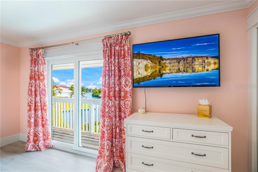 Another beautiful view through the impact-glass sliders in the third master suite - Single Family Home for sale at 511 Loquat Dr, Anna Maria, FL 34216 - MLS Number is T3196169