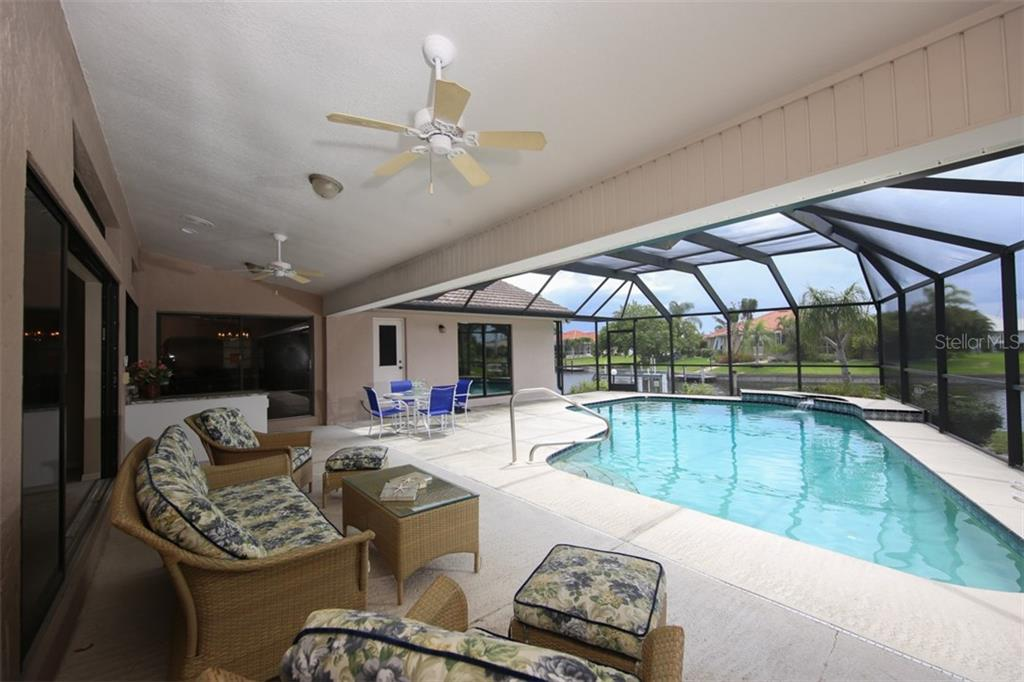 Spacious covered lanai looks at the sparkling pool and amazing canal basin view - Single Family Home for sale at 3419 Sandpiper Dr, Punta Gorda, FL 33950 - MLS Number is C7232529