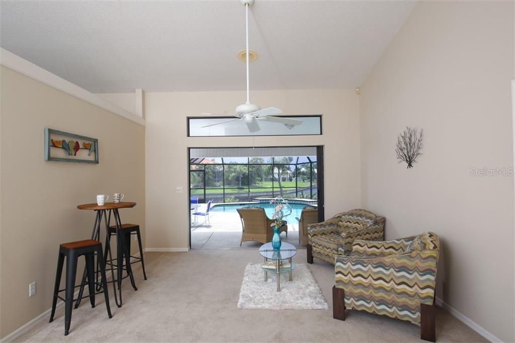 Beautiful view of the pool and canals from living room the minute you walk in - Single Family Home for sale at 3419 Sandpiper Dr, Punta Gorda, FL 33950 - MLS Number is C7232529