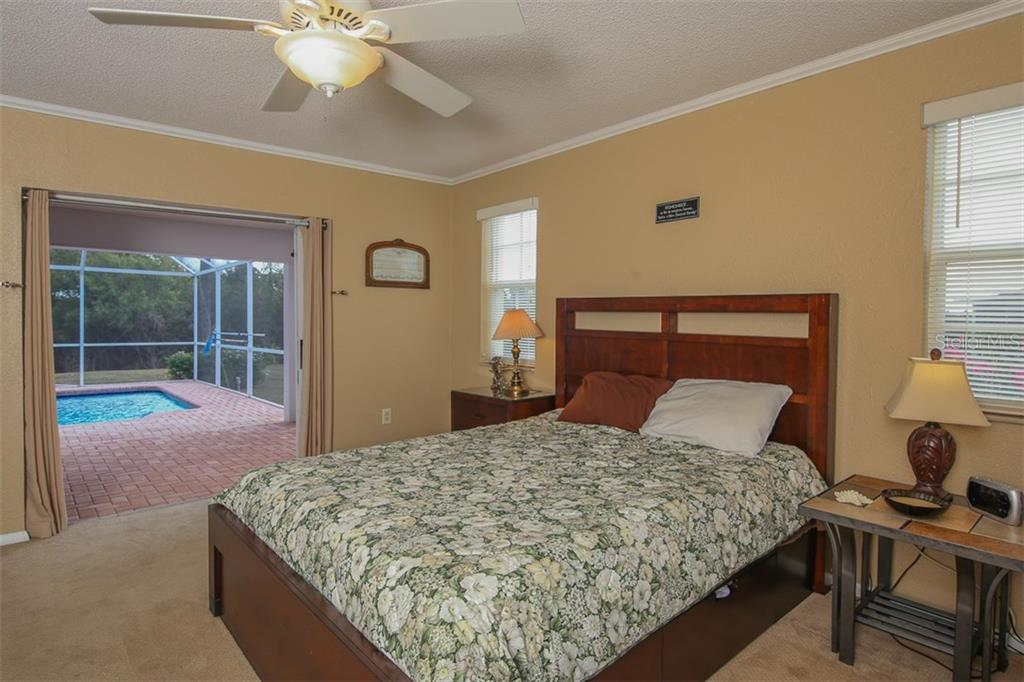 Owner's bedroom with hurricane impact sliders to Lanai & pool area - Single Family Home for sale at 2332 Mauritania Rd, Punta Gorda, FL 33983 - MLS Number is C7234250