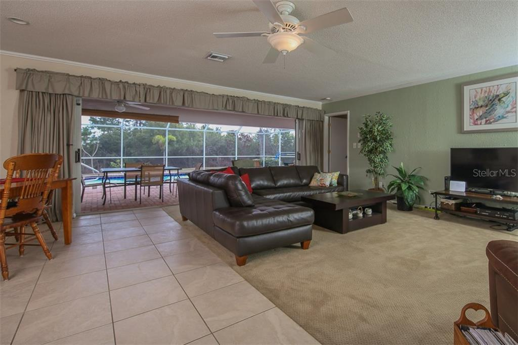 Great Room with expansive opening to Lanai & pool. - Single Family Home for sale at 2332 Mauritania Rd, Punta Gorda, FL 33983 - MLS Number is C7234250