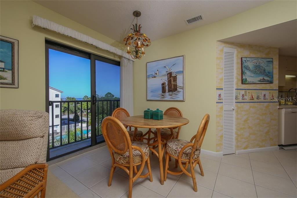 Kitchen nook with sliders and lanai to enjoy lovely outdoors - Condo for sale at 1765 Jamaica Way #302, Punta Gorda, FL 33950 - MLS Number is C7234643