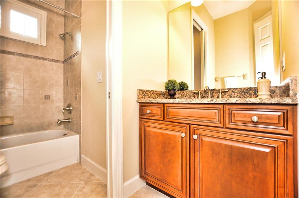 Bathroom #3 with solid-wood vanity, granite counter, complete with tub and shower. - Single Family Home for sale at 2839 Mill Creek Rd, Port Charlotte, FL 33953 - MLS Number is C7238545