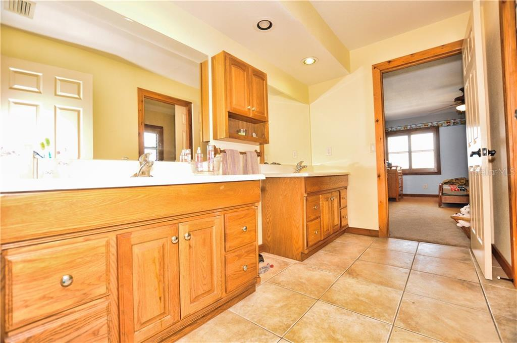 Adjoining guest bathroom - Single Family Home for sale at 30720 Washington Loop Rd, Punta Gorda, FL 33982 - MLS Number is C7239690