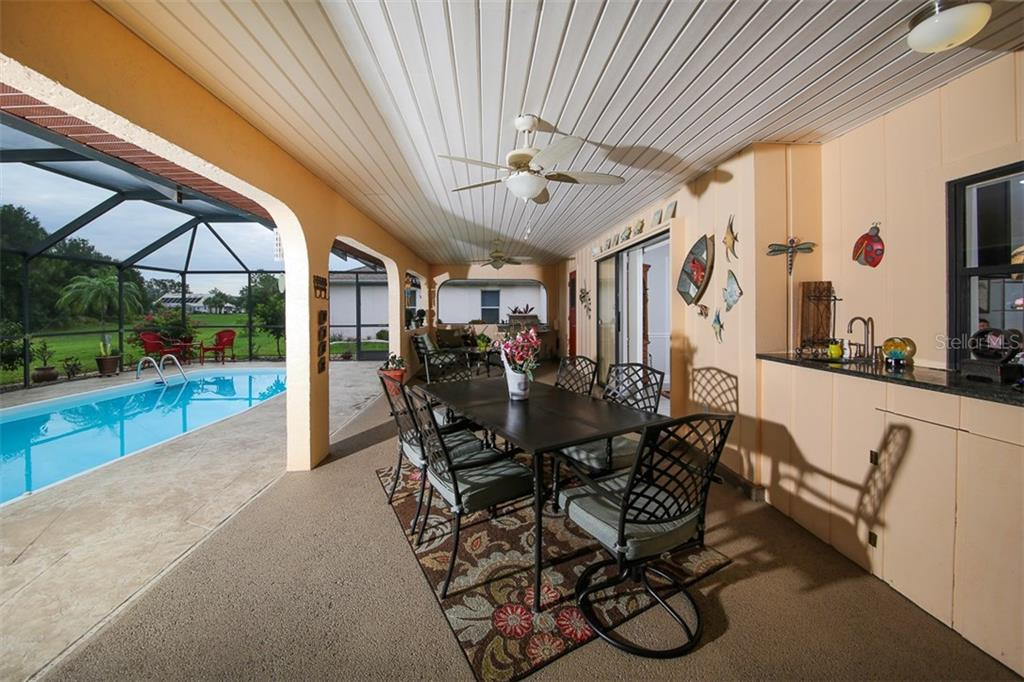 Huge covered lanai is great for entertaining, enjoying your morning coffee and evening libation! - Single Family Home for sale at 26178 Rampart Blvd, Punta Gorda, FL 33983 - MLS Number is C7240559