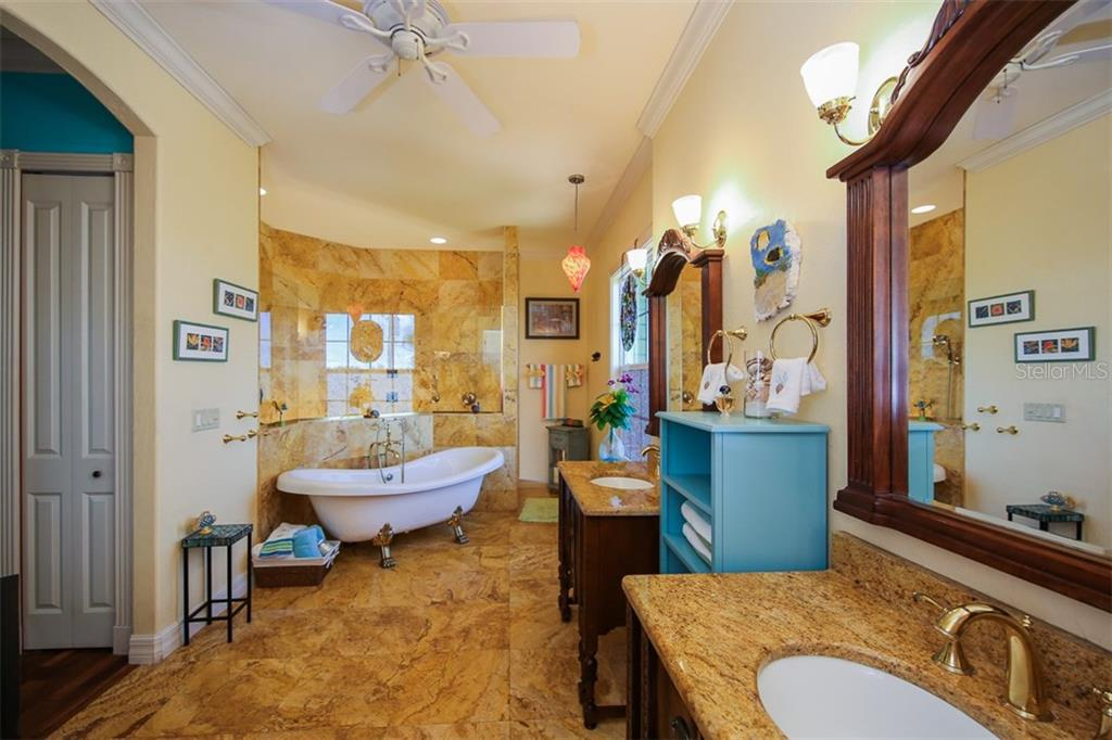 Stunning does not begin to describe this master bathroom with claw soaking tub and amazing walk-in tile shower - Single Family Home for sale at 17296 Foremost Ln, Port Charlotte, FL 33948 - MLS Number is C7240998