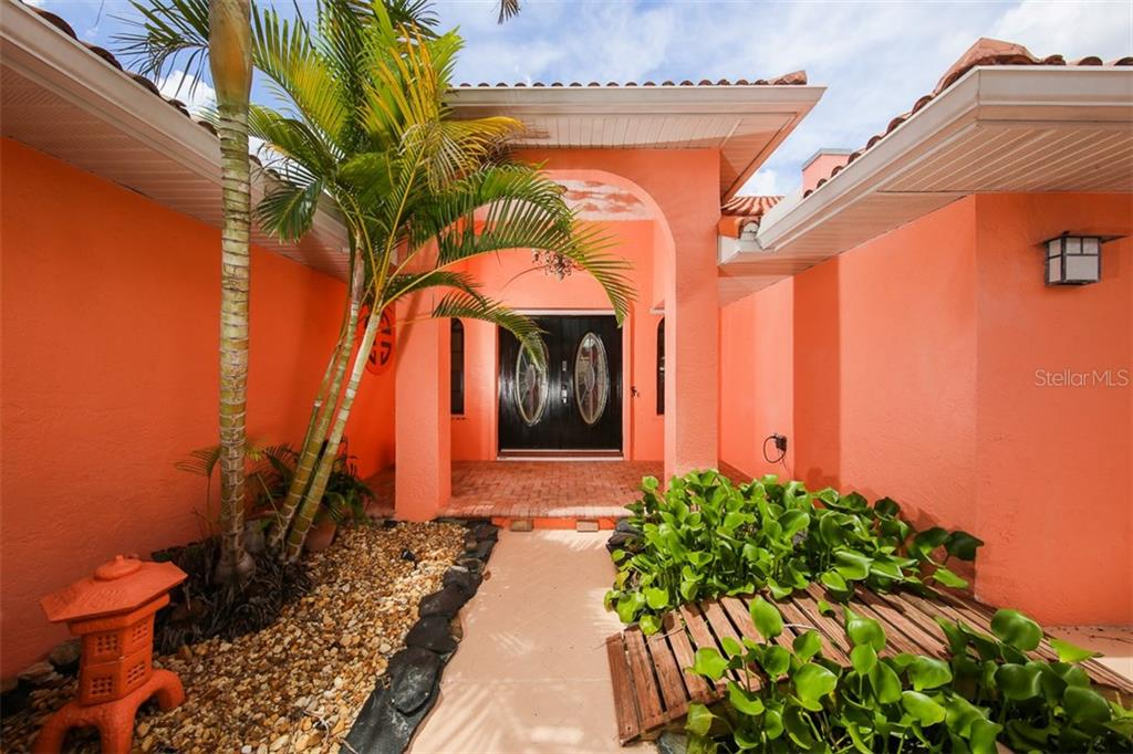 Lovely entrance with oriental flair - Single Family Home for sale at 1620 Appian Dr, Punta Gorda, FL 33950 - MLS Number is C7242315
