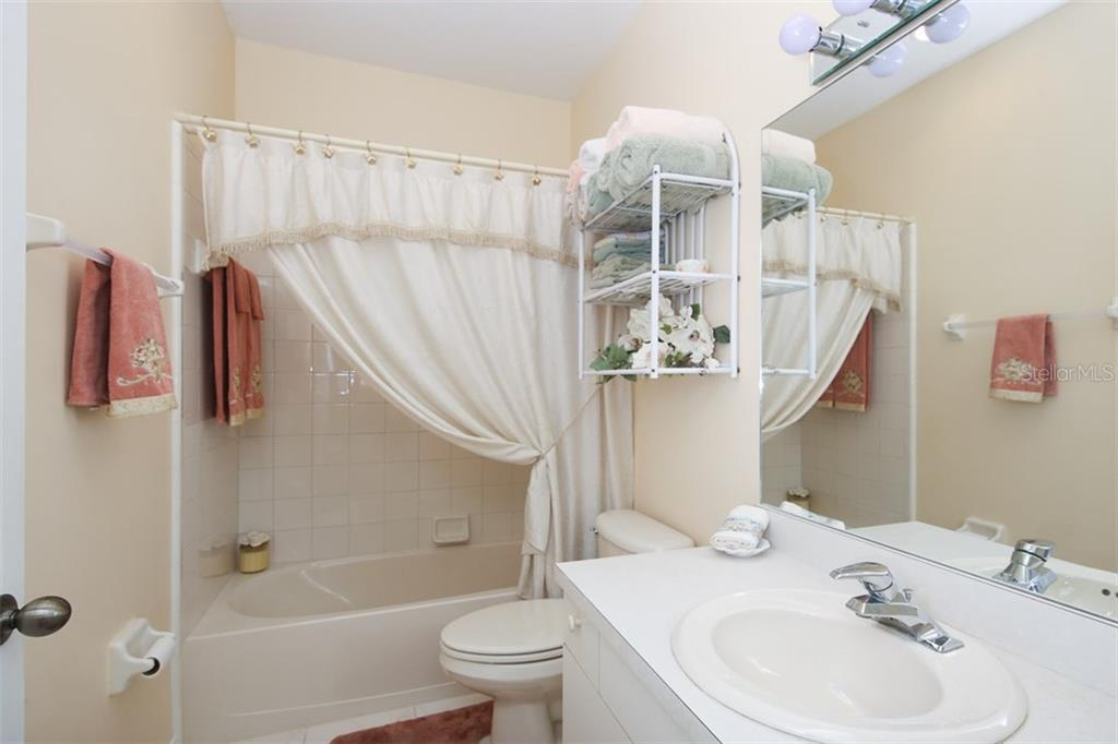 Guest bathroom with shower/tub combination - Villa for sale at 1234 Green Oak Trl, Port Charlotte, FL 33948 - MLS Number is C7243720
