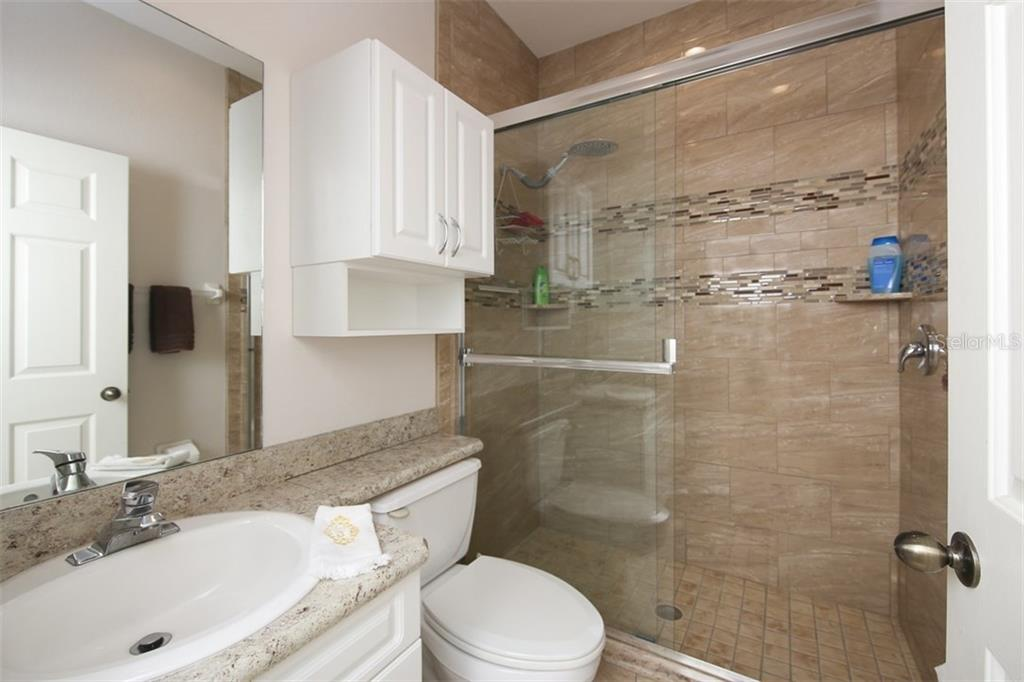 Guest bathroom was recently remodeled with granite counters and a beautiful walk-in shower - Villa for sale at 1268 Green Oak Trl, Port Charlotte, FL 33948 - MLS Number is C7243755