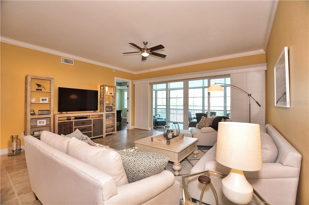 Great Room overlooking lanai - Condo for sale at 95 N Marion Ct #136, Punta Gorda, FL 33950 - MLS Number is C7243837