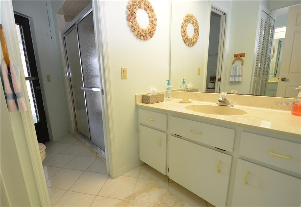Guest bath with access to pool - Single Family Home for sale at 2601 Parisian Ct, Punta Gorda, FL 33950 - MLS Number is C7244389