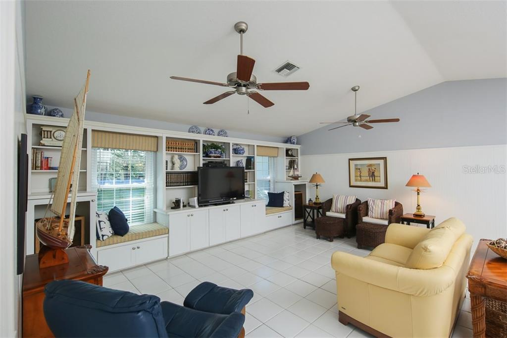 Family room with tile flooring - Single Family Home for sale at 4407 Albacore Cir, Port Charlotte, FL 33948 - MLS Number is C7245070