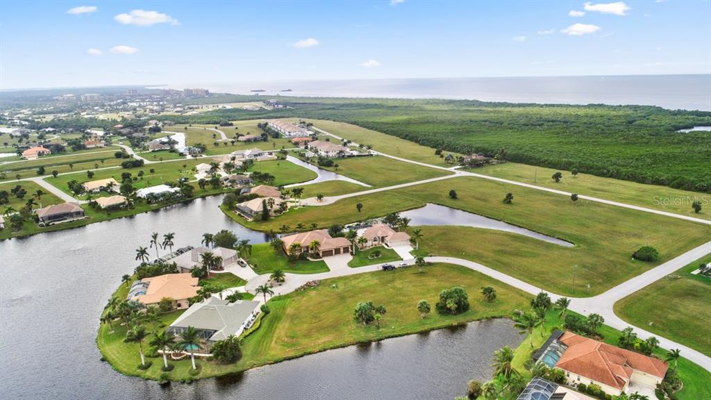 In this aerial you can see the close proximity of this home to Charlotte Harbor which is the gateway to the Gulf of Mexico! - Single Family Home for sale at 17208 Barcrest Ln, Punta Gorda, FL 33955 - MLS Number is C7245458
