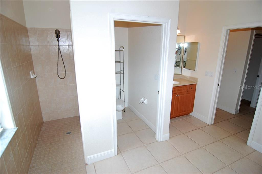 Master bath with garden tub and walk-in shower - Single Family Home for sale at 7376 Schefflera, Punta Gorda, FL 33955 - MLS Number is C7245991
