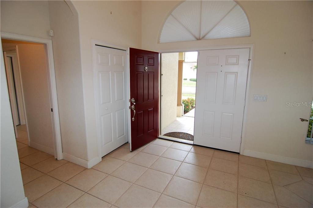 Front door.  Master bedroom is on left and formal dining area on right. - Single Family Home for sale at 7376 Schefflera, Punta Gorda, FL 33955 - MLS Number is C7245991