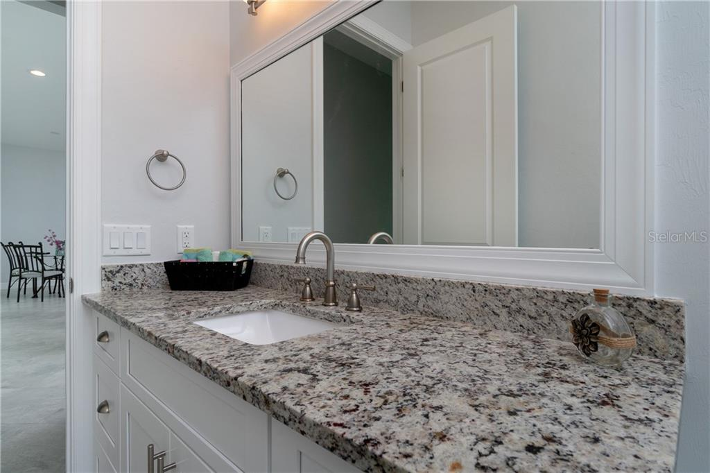 Guest bath with over-sized vanity and granite counters - Single Family Home for sale at 3302 Palm Dr, Punta Gorda, FL 33950 - MLS Number is C7247251