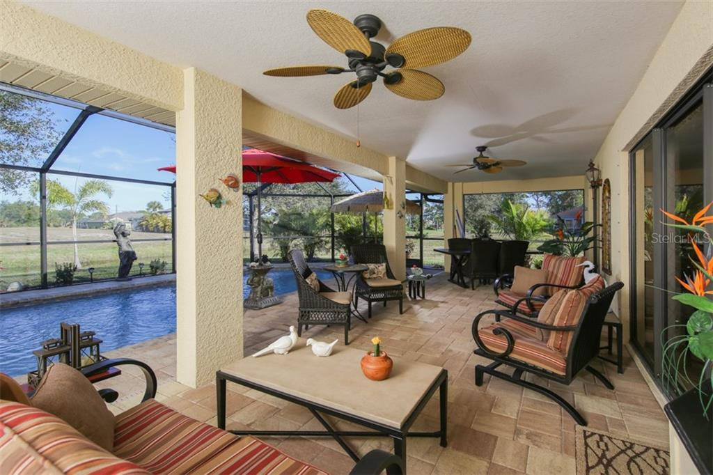 This has the WOW factor - the perfect spot for enjoying your morning coffee or evening cocktail! - Single Family Home for sale at 220 Broadmoor Ln, Rotonda West, FL 33947 - MLS Number is C7248036