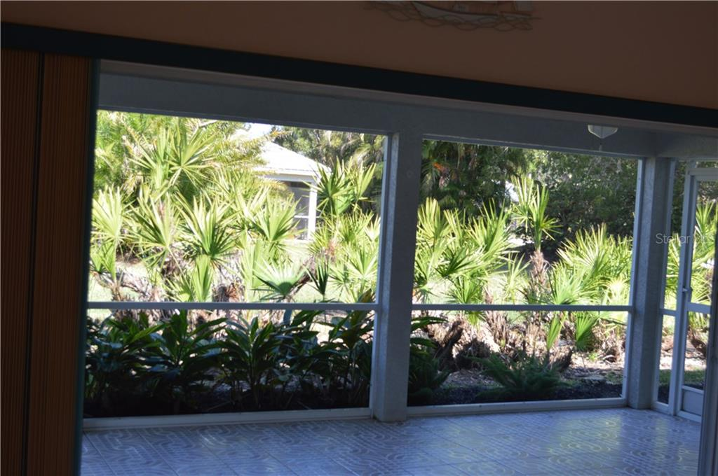 ***Large Lanai With Tropical Setting***Note That The Sliders Pocket Which Enhances The View*** - Single Family Home for sale at 501 Islamorada Blvd, Punta Gorda, FL 33955 - MLS Number is C7248962