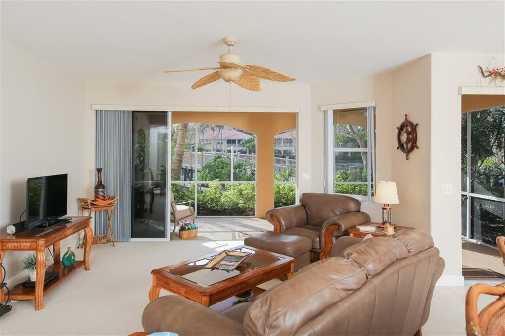 Sliding glass doors open to the generous lanai from both the great room and café. - Condo for sale at 3392 Sunset Key Cir #b, Punta Gorda, FL 33955 - MLS Number is C7249092