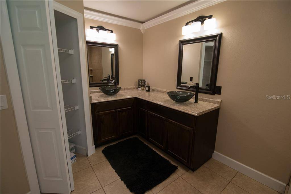 Your master ensuite has dual sinks and a walk-in shower. You'll also appreciate the large walk-in closet with lots of storage. - Single Family Home for sale at 3184 Ulman Ave, North Port, FL 34286 - MLS Number is C7400587