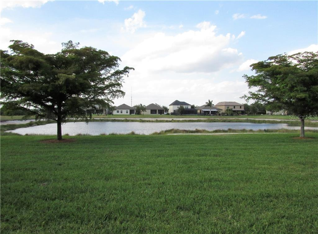 Back yard view from the patio - Single Family Home for sale at 24041 Canal St, Port Charlotte, FL 33980 - MLS Number is C7400879