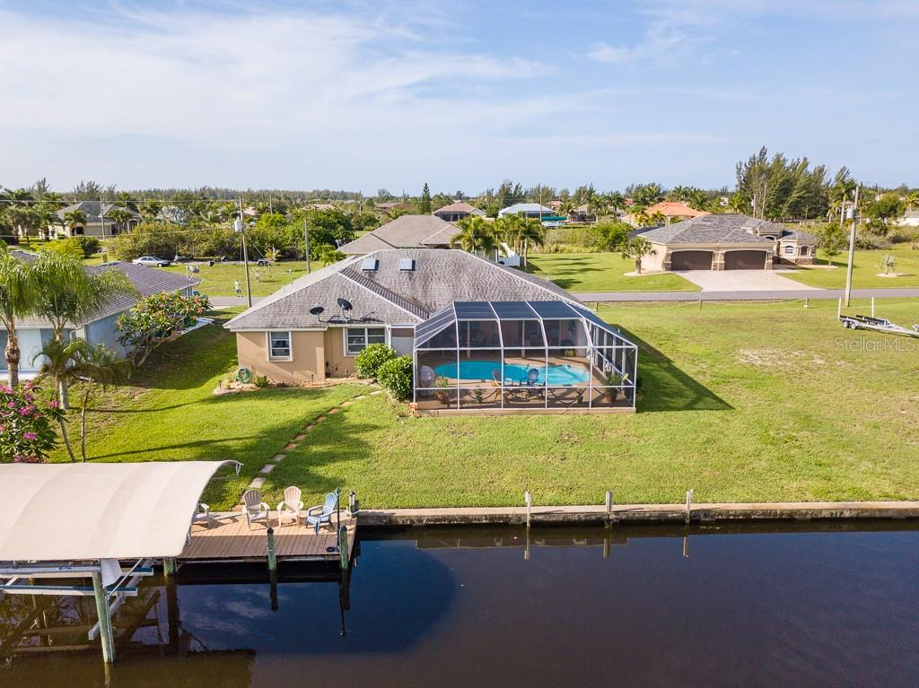 RELAX ON YOUR LANAI, ENJOY THE POOL OR PERHAPS TAKE THE BOAT OUT OR JUST FISH FROM YOUR OWN DOCK! - Single Family Home for sale at 15464 Avery Rd, Port Charlotte, FL 33981 - MLS Number is C7401914