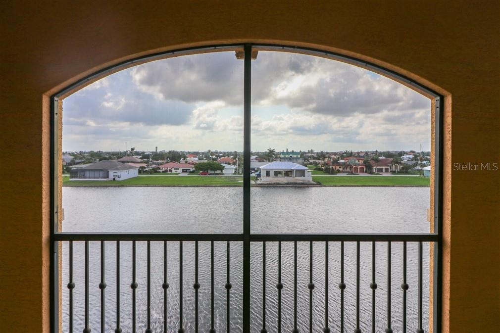Lanai view over the lake - Condo for sale at 94 Vivante Blvd #9445, Punta Gorda, FL 33950 - MLS Number is C7402021
